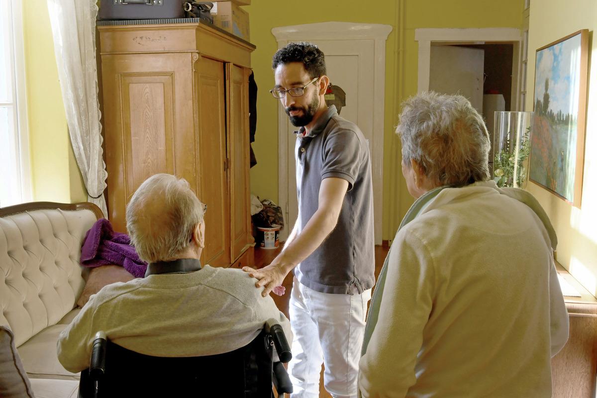 Refugee works in senior living community