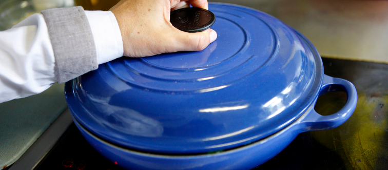 Placing Lid on blue Pot