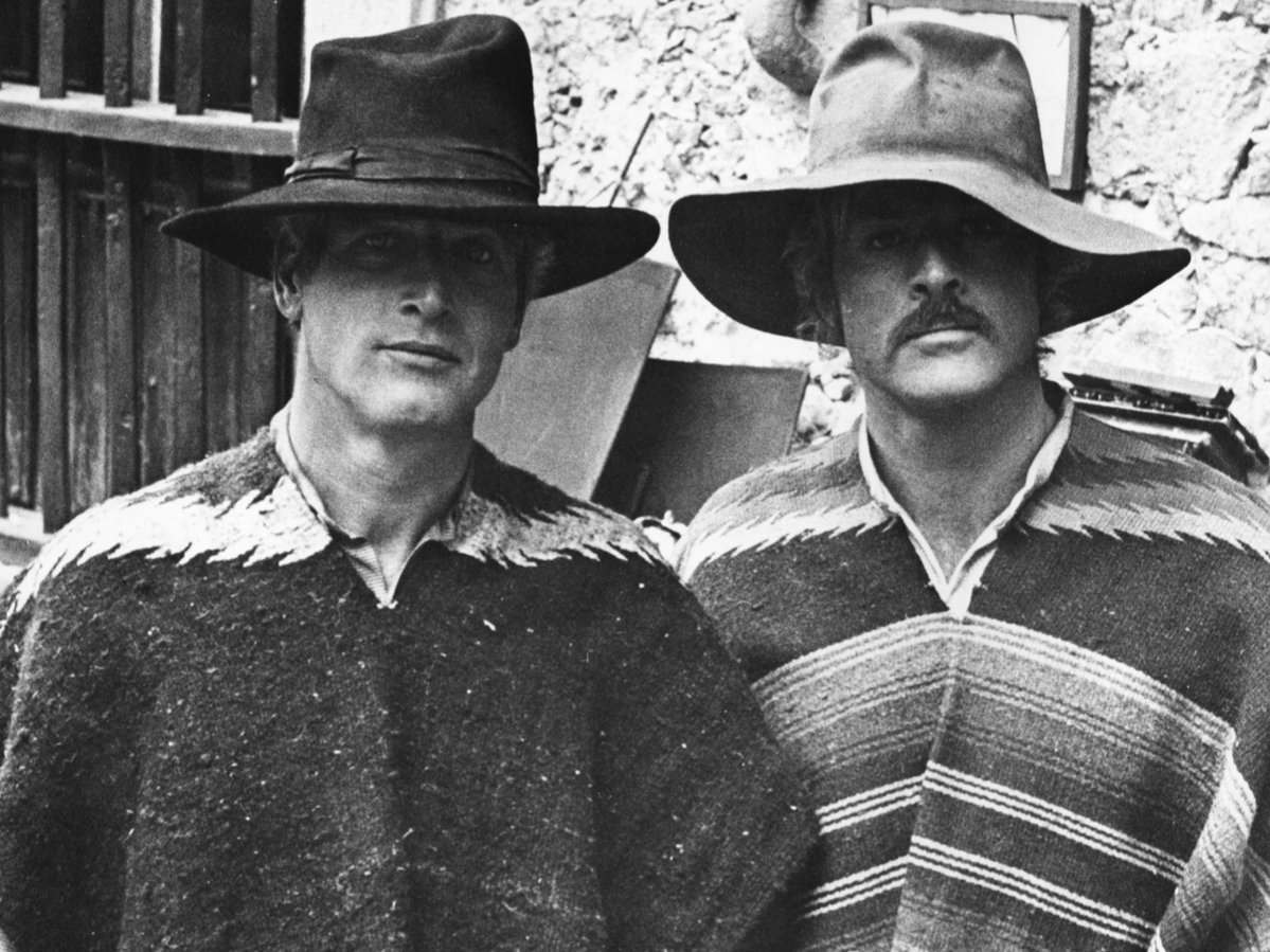 Portrait of actors Paul Newman (left) and Robert Redford, wearing ponchos and hats, on the set of the movie 'Butch Cassidy and the Sundance Kid', 1969.