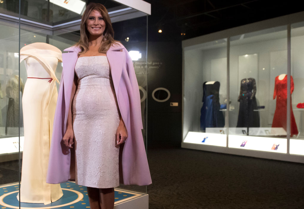 US First Lady Melania Trump stands alongside the gown she wore to the 2017 inaugural balls