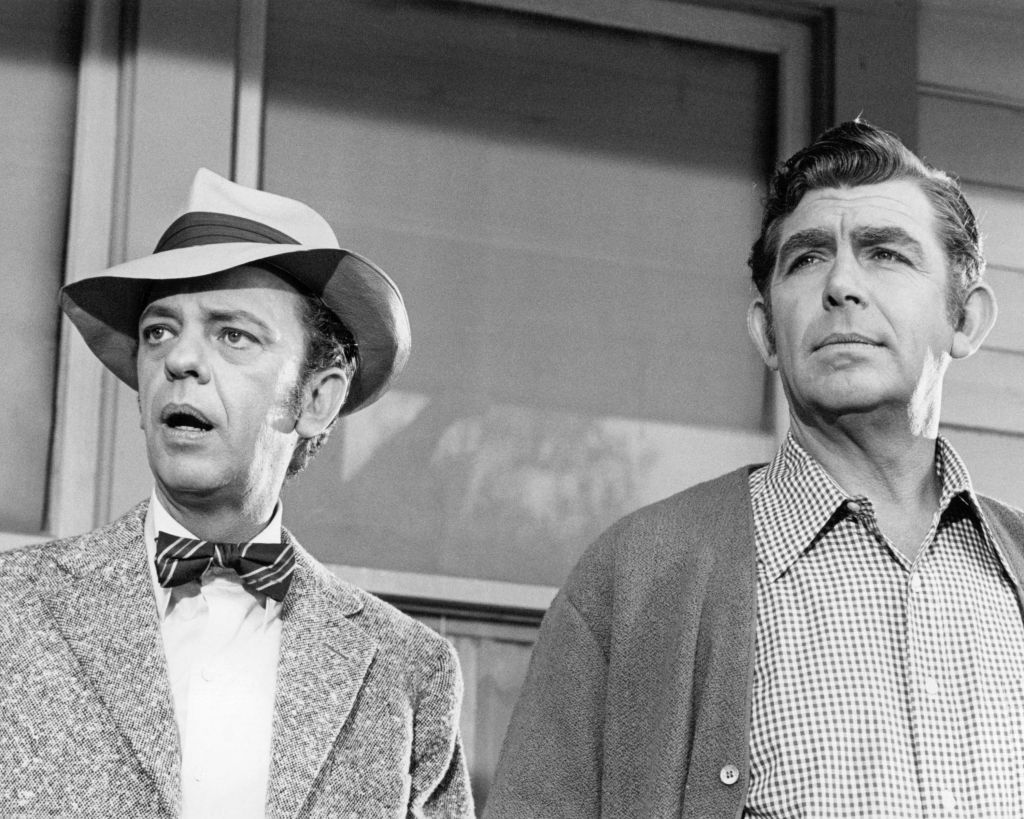 Don Knotts as Barney Fife, and Andy Griffith as Sheriff Andy Taylor