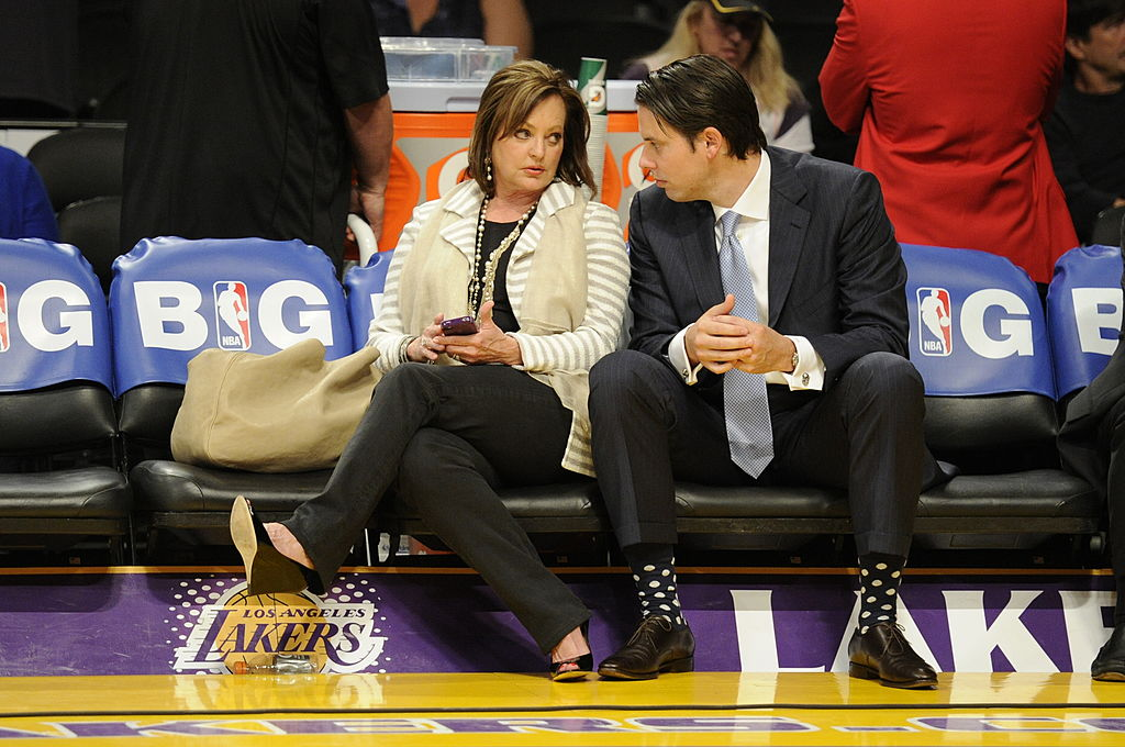 Ann and Josh Kroenke chat before game 7 of the first round of the NBA playoffs