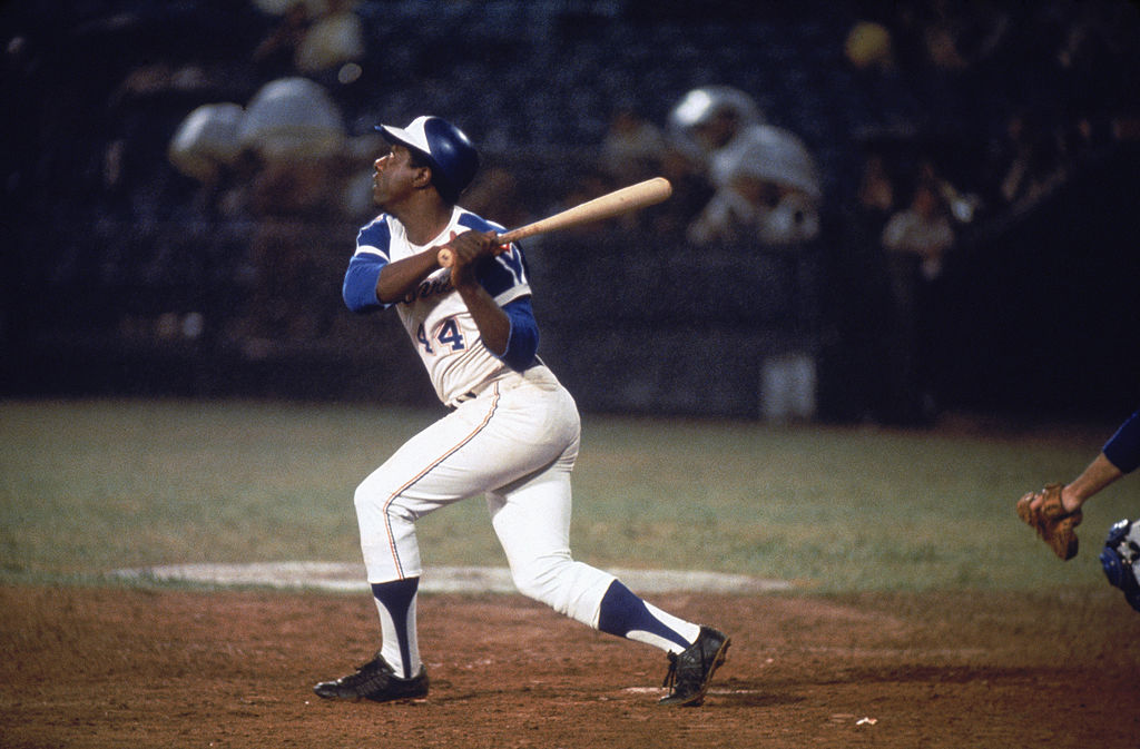 Hall of famer Hank Aaron of the Atlanta Braves swings at the ball
