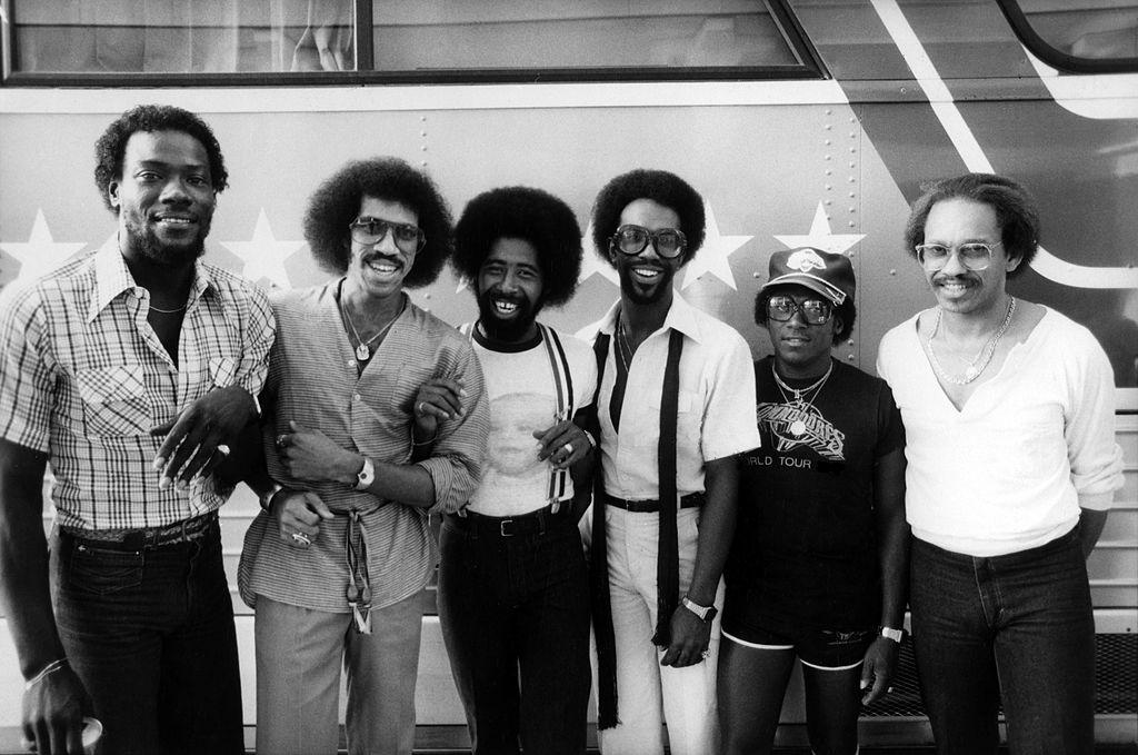 Lionel Richie second left, posed, group portrait