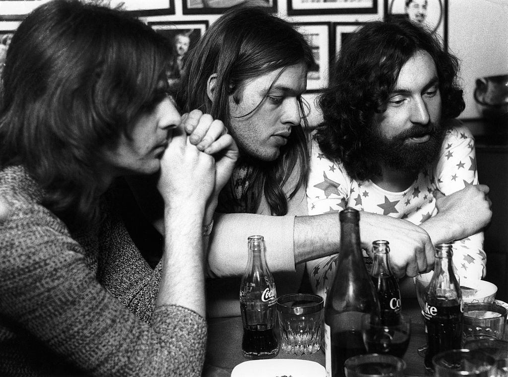 Pink Floyd sitting at a table