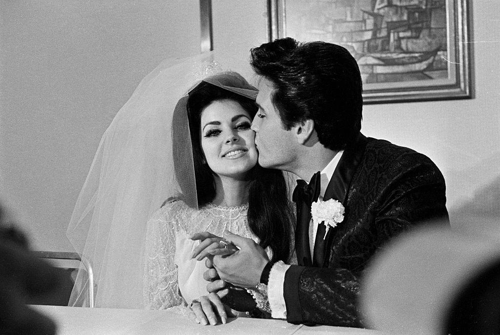 Elvis Presley gives his new bride, Priscilla Ann Beaulieu